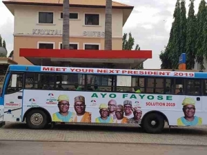 """""""Meet Your Next President 2019"""": Fayose Presidential Campaign Buses Spotted In Abuja"""